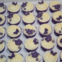 Purple flowers & butterflies wedding cupcakes