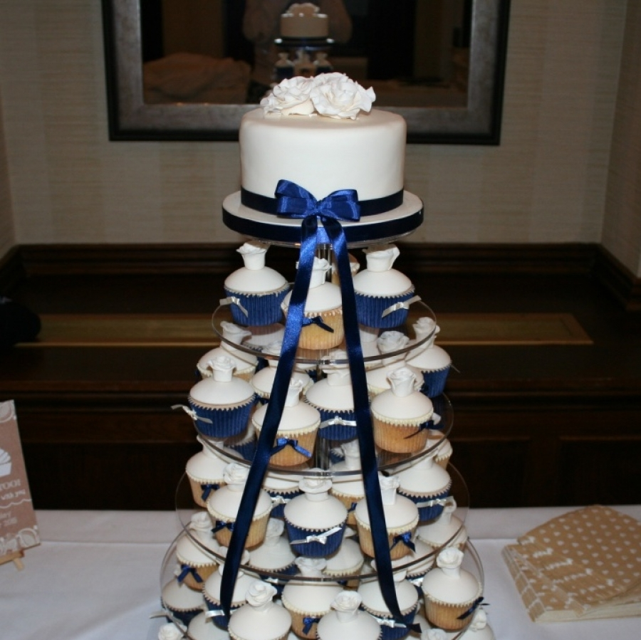 navy wedding cake with cupcakes navy ivory cupcake tower 17794