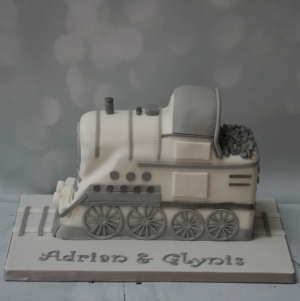 White and silver steam train wedding cake