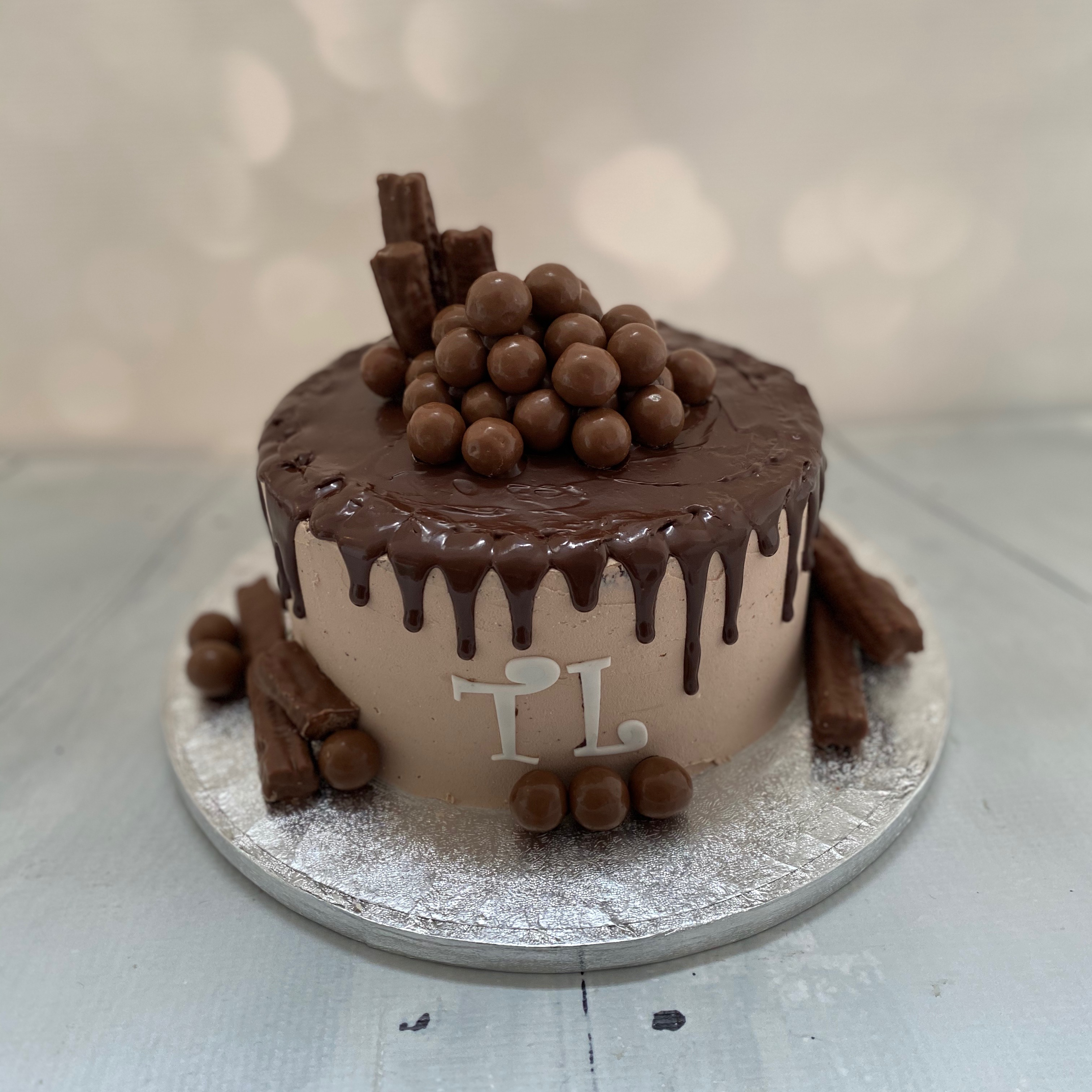 Flake & maltesers chocolate drip cake