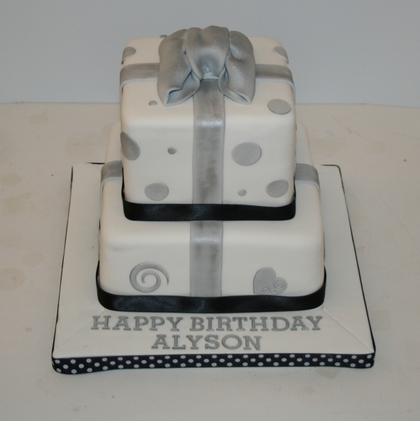 Two tier present cake - black, white & silver