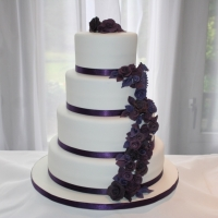 4 tier purple flowers wedding cake