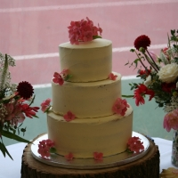 Semi-naked wedding cake with sugar hydrangeas