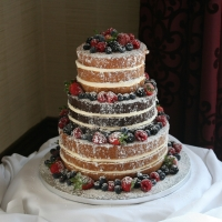 3 tier 'naked' wedding cake with fresh fruit