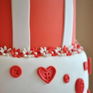 Red & White wedding cake button close up