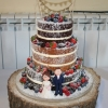 3 tier naked wedding cake with clay figures