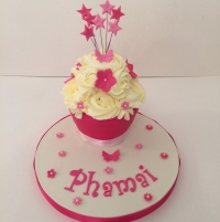 Bright pink baby giant cupcake