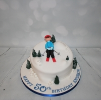 Skiing themed 50th birthday cake