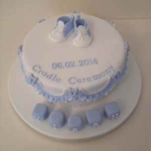Baby sneakers boys' christening cake