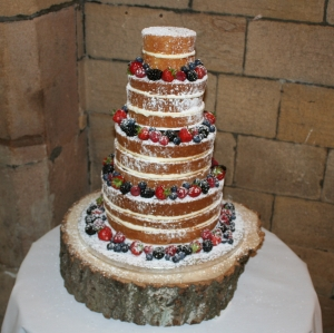 4 tier naked cake with berries