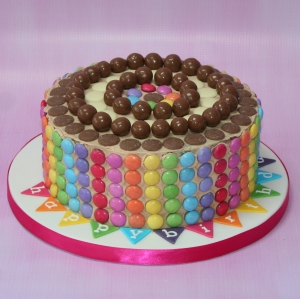 Smarties, buttons & maltesers cake