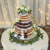 3 tier 'naked' wedding cake with fresh flowers & sugar figures