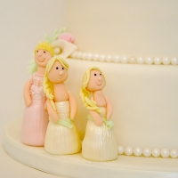 Bridesmaid on wedding cake