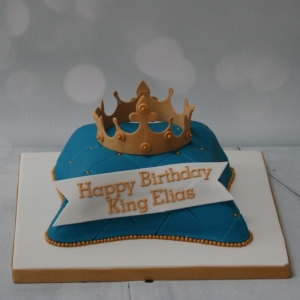 Blue pillow cake with crown